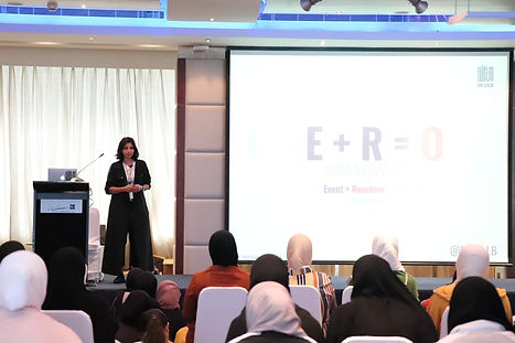 Noura AlSabah MNGALB psychology talk in a convention about mental health and resilience