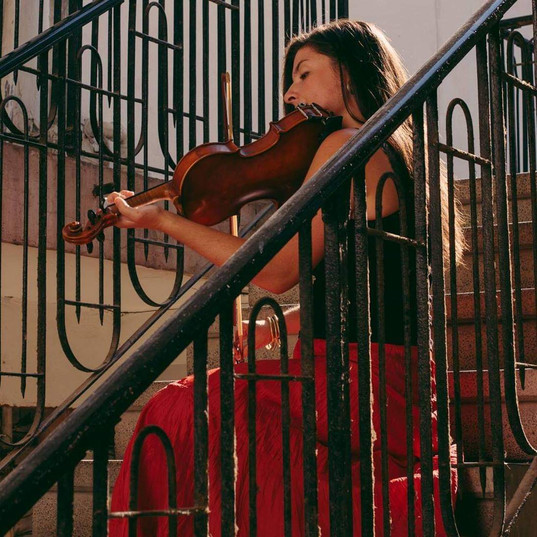Cara fiddle on stairs.jpg