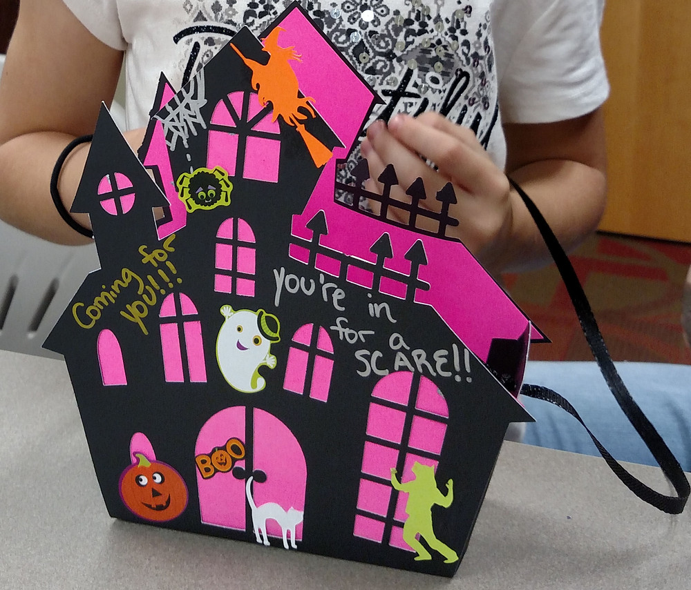 decorate a paper haunted house