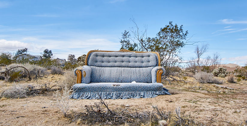 Lonely couch in the desert, by photographer Lia Roozendaal