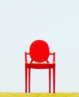 red-armchair-on-brown-surface-910625_edi