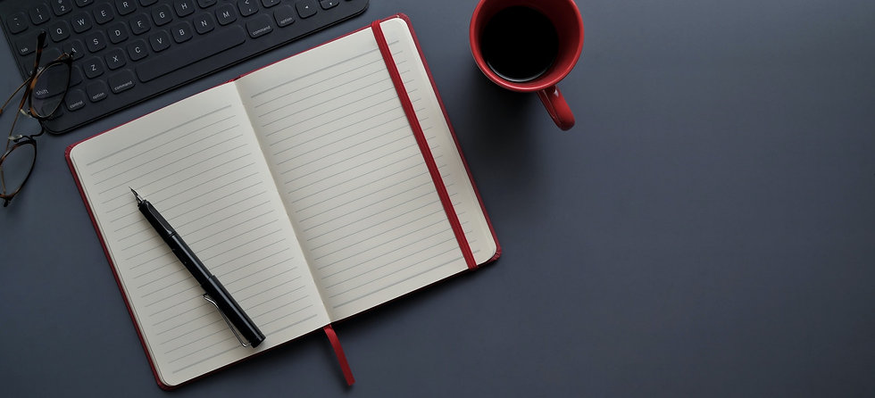 notebook-and-pen-beside-red-mug-on-gray-