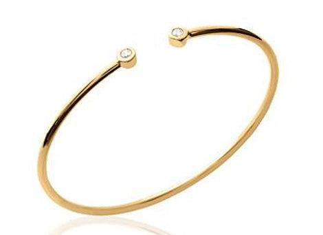 Bracelet jonc rigide en plaqué or et oxyde de zirconium.