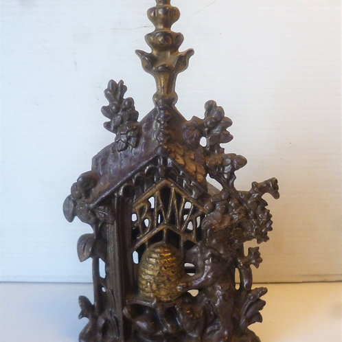 Victorian cast iron bear and honey money box
