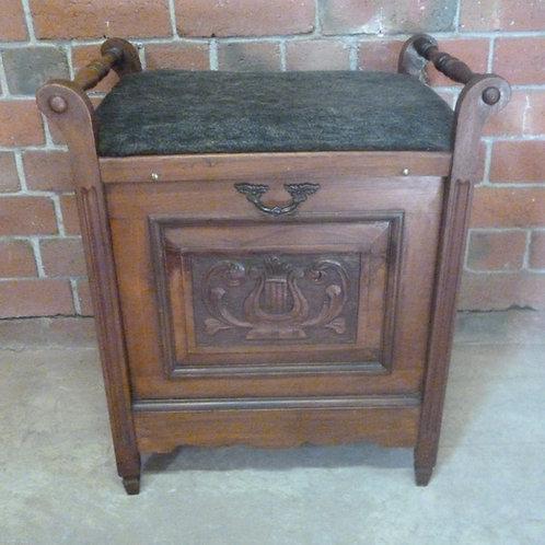 Late Victorian walnut piano stool music cabinet