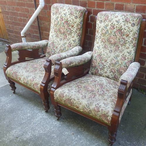 Pair of Edwardian blackwood arm chairs