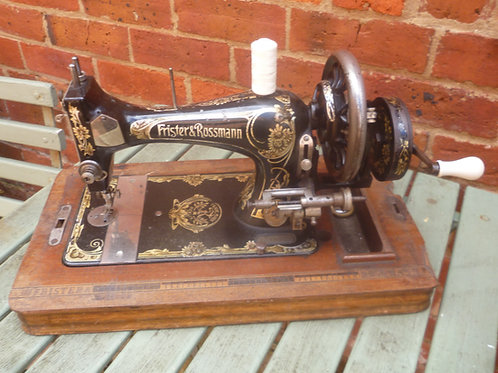 Antique Frister and Rossman hand operated sewing machine