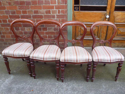 Set of four Victorian style mahogany balloon back chairs