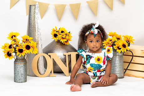 One year old baby girl with white romper