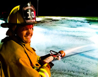 Contentnea Firefighter with hose smiling
