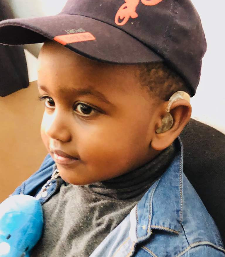 Showing off his hearing aids