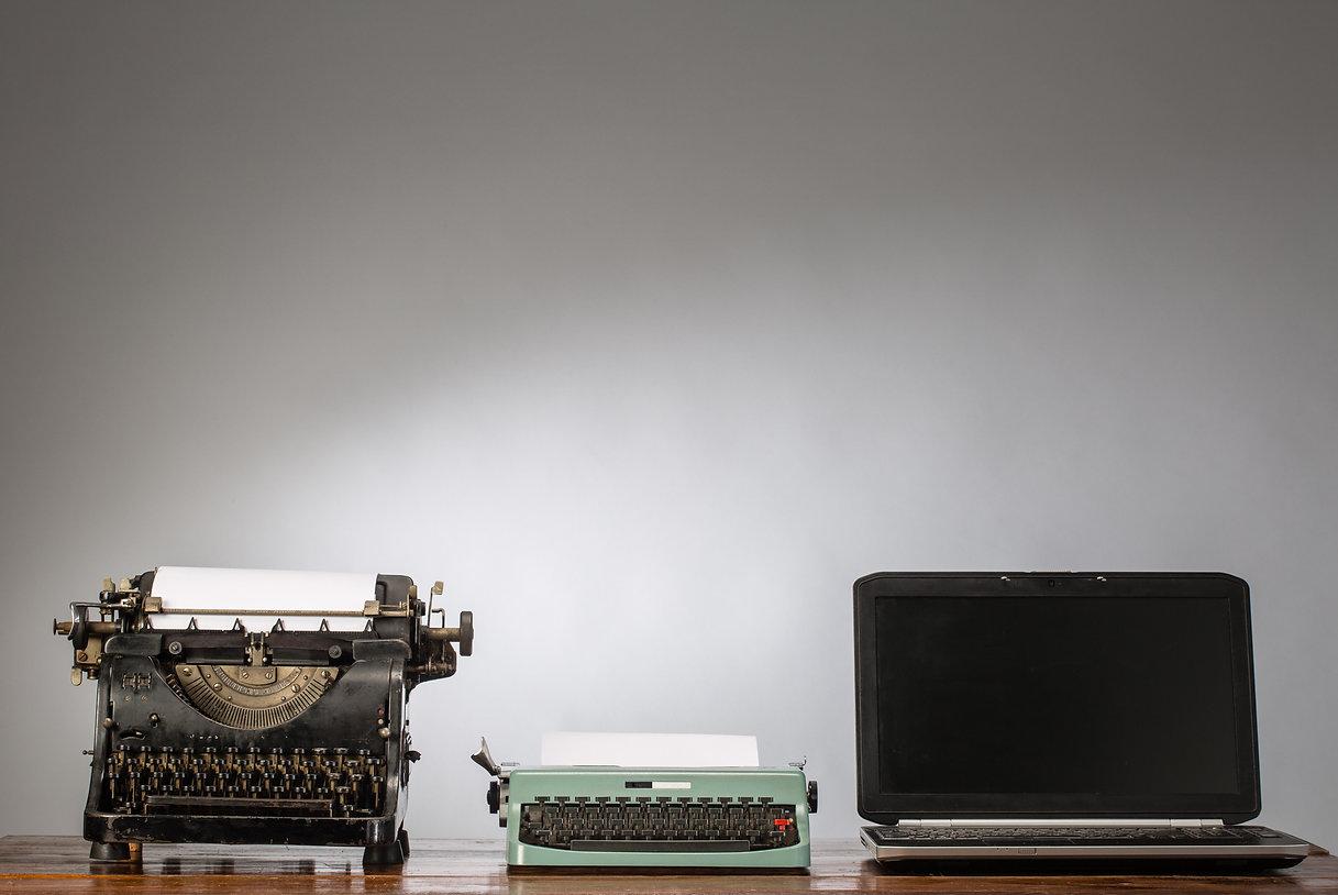 Vintage typewriter and laptop.jpg