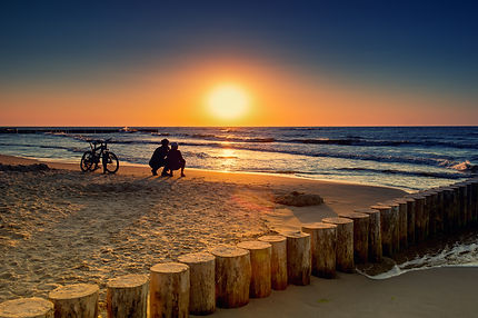 Family with bicycles on the lakefront at sunset.jpg