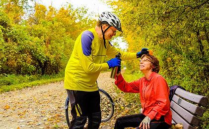 couple cycling in fall.jpg