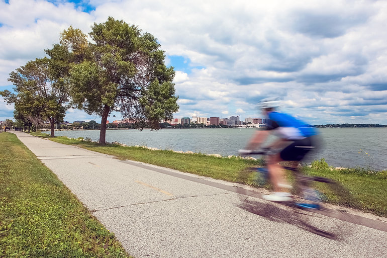 Motion Blur of a person riding a bicycle