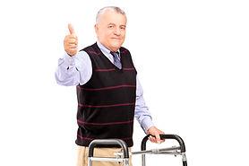 A mature gentleman using a walker and g