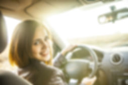woman in car indoor keeps wheel turning