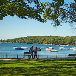 The Shore Path around Geneva Lake features historic estates with well kept lawns and gardens, the clear blue waters of Geneva Lake with sailboats, excursion boats, and antique wooden boats.