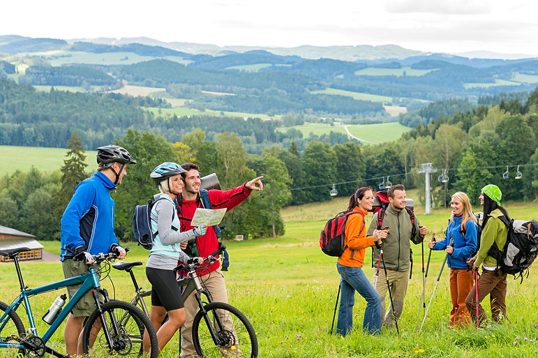 Hikers helping cyclists following track