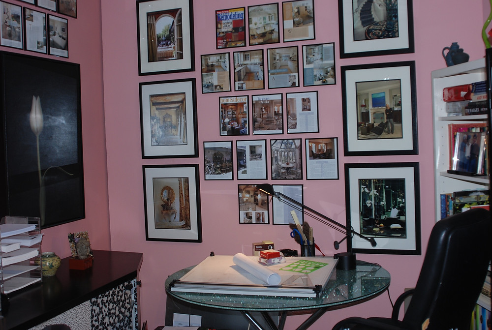 Pink walls set off the feminine power of the office space and allows the art to stand out