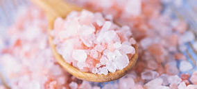 Pink salt in wooden scoop