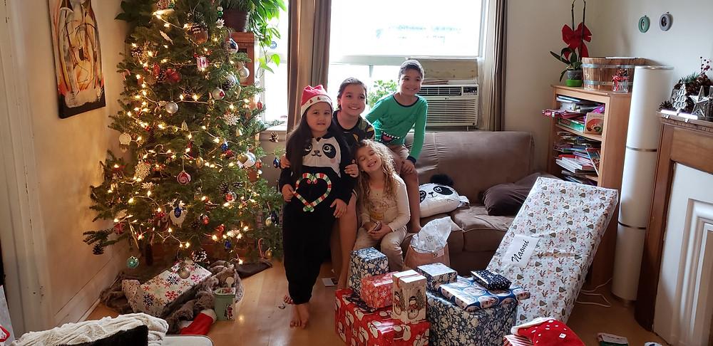 Children, presents, lit Christmas tree