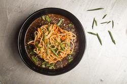 Noodles in black pepper sauce bowl