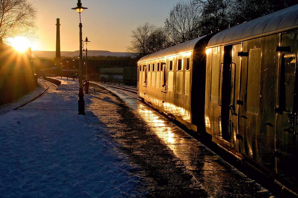 The 104 DMU sits at Rawtenstall in the low evening sun - ©Rory Lushman
