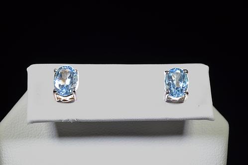 Sterling Silver Oval Blue Topaz Studs