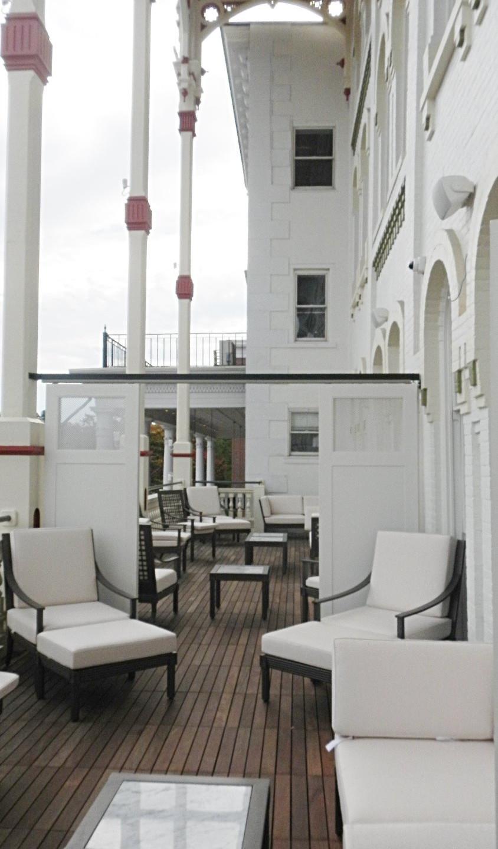 The Adelphi Hotel balcony overlooks Broadway in Saratoga Springs, NY