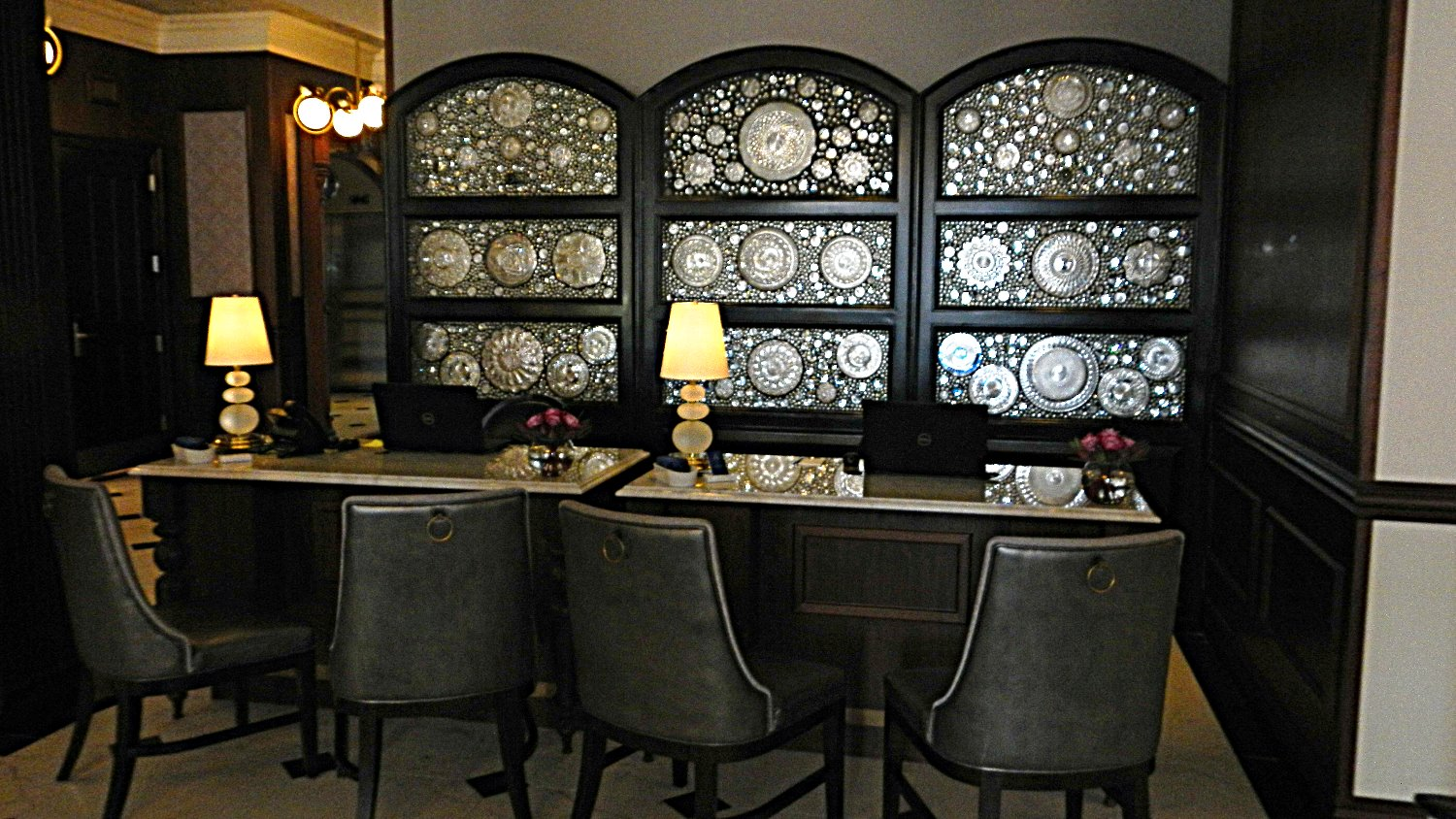 Dinner plates from the original hotel were used in the decor of the reception area at The Adelphi Hotel