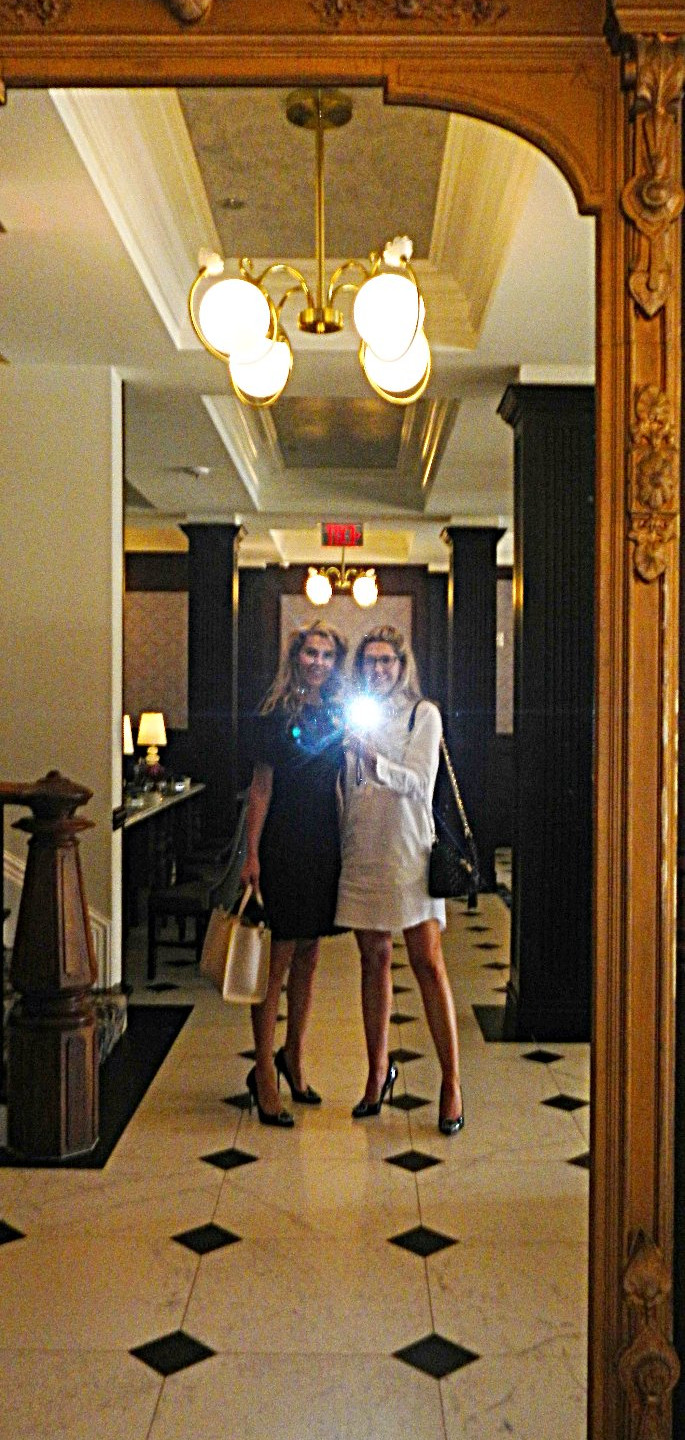Interviewers, Brittany Alexander and Megan Alexander, snap a selfie in the restored mirror in The Adelphi Hotel lobby, while touring the hotel to take photos for the blog