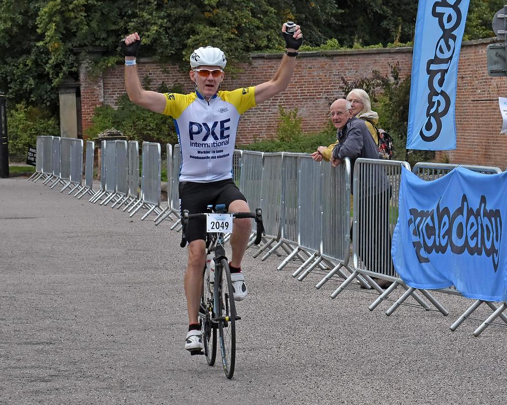 Al crossing the finish line at Markeaton Park