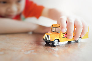 Canva - Yellow school bus toy model in c