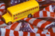 Canva - School Bus and American Flag Bac