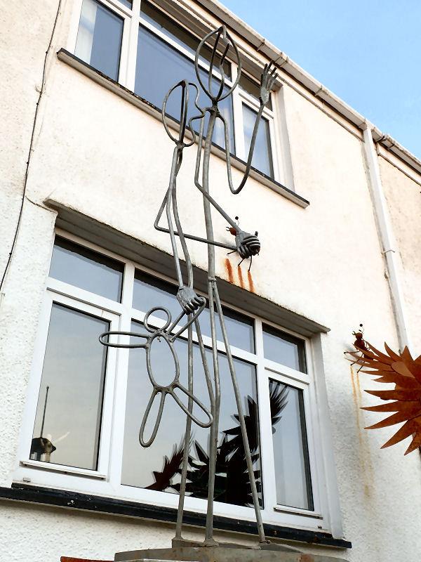 Human figure metal sculpture