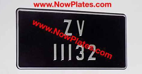 1 of Vintage Black and Silver Pressed Plate with Small No's
