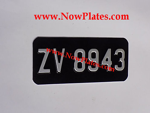 Black and Silver Pressed Motorcycle Plate with Small No's  7x4ins