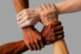 racism hands holding.jpg