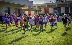 Students running in the annual turkey trot