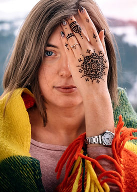 young-attractive-woman-covering-eye-with-mehndi-hand_211251-78.jpg