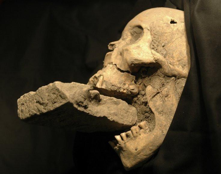 Presumed anti-vampire measures applied to a skull in Italy