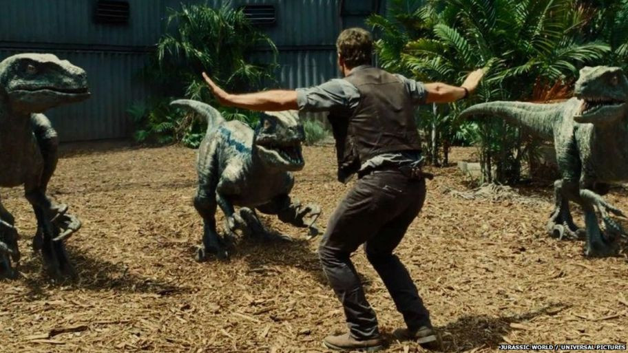 Chris Pratt showing how zookeeping is done with velociraptors