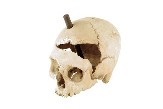 Witch skull with iron stake embeded