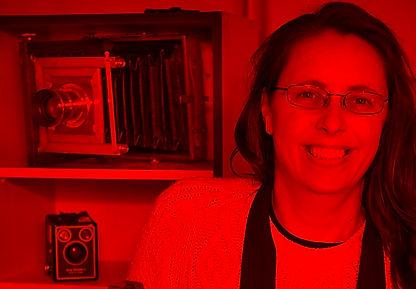 Sue Jones headshot in darkroom.jpg