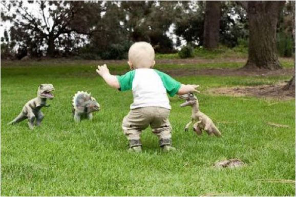 Controlling dinosaurs with a power stance by a baby