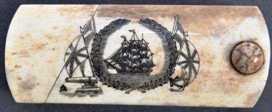 Scrimshaw puzzle box with engraving of ship