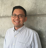 man with glasses, smiling