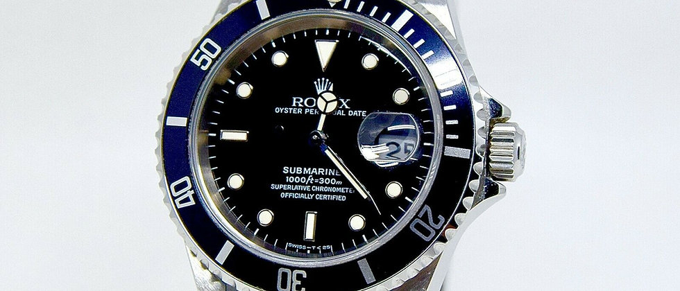 .Rolex Submariner 16610 NEW/UNWORN Box and Papers 1996