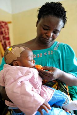 Masika holding Espoir in hospital